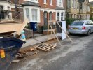 Builders blocking pavement and parking on double yellow lines.