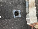 Collapsed drain cover On Chruch Street near Changing Lives charity shop